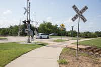 The railroad crossing that intersects with a walking and bike trail near the intersection of Lakeview Boulevard and West Shady Shores Road.  A 28-year-old cyclist was struck by a Denton County Transportation Authority A-train on Tuesday near this railroad crossing.DRC
