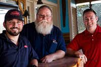 """<p><span style=""""font-size: 1em; background-color: transparent;"""">Ed Pickrel, center, and his sons Edward, left, and James stand in their uniforms after a hard day's work at Peterbilt in Denton. Ed has worked for Peterbilt for 30 years, James for seven years and Edward six.</span></p>DRC"""