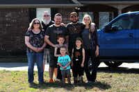 Three generations of Pickrels stand in front of James Pickrel's house in Pilot Point in February before leaving for a basketball game.DRC