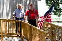 "Michael Loya, left, and Robert ""Bill"" Steele stand on Steele's finished wheelchair ramp in front of his home in June in Denton. Volunteers began building the ramp in November 2016, finishing it in April 2017.DRC"