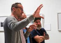 "Actor and photographer Jason Lee, left, talks about his photos on display with Will Gillman, second from right, and Chris Brown, right, on Thursday, May 11, 2017 at Kettle Art Gallery in Dallas. Lee starred in the television show ""My Name is Earl"" and the movie ""Mallrats,"" among others. His photos are accompanied with written excerpts by Sebastian Hasani Paramo. The Dallas Morning News"