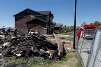 In this May 4 file photo, workers dismantle the charred remains of a home where an unrefined petroleum industry gas line leak explosion killed two people inside their home in Firestone, Colo. Energy companies are reporting they have nearly 129,000 underground oil and gas pipelines within 1,000 feet of occupied buildings in Colorado.AP