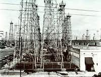 'The World's Richest Acre' in downtown Kilgore in the  1930s — it had 24 oil wells drilled into one block.DMN file photo