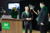 University of North Texas athletic director Wren Baker, right, introduces Grant McCasland as the school's new head basketball head coach on March 21 at the UNT Union.DRC