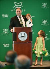 Wren Baker speaks to the crowd with his daughters Reagan and Addisyn at a press conference at Apogee Stadium after being introduced as the University of North Texas' new athletic director on Aug. 1, 2016.