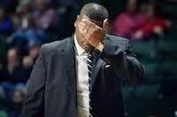 Former University of North Texas men's basketball coach Tony Benford wipes his face while walking the sidelines during a game last season at the UNT Coliseum. UNT athletic director Wren Baker fired Benford at the end of his fifth season with the Mean Green. UNT did not finish above .500 in any of Benford's five seasons at the school.DRC