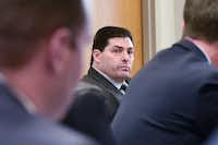 New city manager Todd Hileman listens in during a city council meeting at City Hall in January. DRC