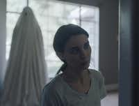 Rooney Mara and Casey Affleck in a scene from the film, <i>A Ghost Story</i>. Affleck plays the ghost in the new David Lowery film.AP