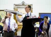Lt. Governor Dan Patrick holds pizza and soda inside the Senators' Room just before the senate reconvenes at 12:01 a.m. for a third reading of the Sunset Bill during the third day of a special legislative session on Thursday, July 20, 2017 at the Texas state capitol in Austin, Texas. (Ashley Landis/The Dallas Morning News)Staff Photographer