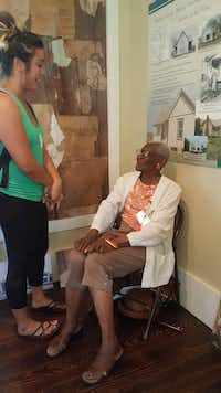UNT film student Valorie Buentello, left, chats with Alma Clark, a longtime resident of Denton whose late husband, William, was a resident of Quakertown, a black settlement in Denton that was forcibly relocated so the city could create a park.UNT Media Arts