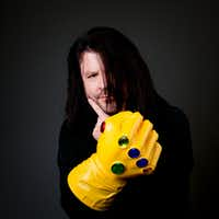 Denton photographer Ed Steele is pictured wielding the Infinity Gauntlet from Marvel Comics.Courtesy photo/file photo
