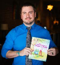 "Rodriguez Middle School Assistant Principal Eric Hauser displays his book ""The Adventures of Pepe and Pede"" on Thursday in Denton. Hauser said he didn't know Pepe the Frog was an alt-right symbol until after the book came out.The Dallas Morning News"