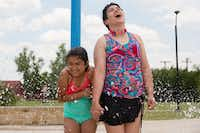 Nine-year-old Jaselle Reynolds spends time with her aunt, Amber Reynolds, at Switzer Park Splash Pad in Sanger.  The pair have a close relationship and spend time with each other frequently. DRC