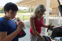 "Amber Reynolds, left, with her mother, Angela Biggs, drinks a smoothie before she rides in another vehicle that will take her back to her room at the Denton State Supported Living Center.    Biggs will give Amber a snack (such as a smoothie) or another tangible item to help ease the transition transition and signal that it's time to go back to the center.  Once she receives the item, Amber will say, ""Bye?"" to her mother as a way to confirm that she is going back to the center.DRC"