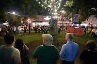 Participants form a wide circle for Saturday evening's candlelight vigil on the lawn of the Courthouse on the Square.DRC