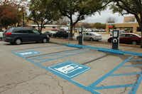 Electric vehicle charging stations sit in the parking lot of Wooten Hall at the University of North Texas.DRC file photo