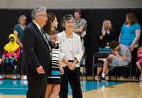 Rosemary Rodriguez, right, watches her husband, Rudy, address the 611 middle school students who began their school year on Wednesday. The district's newest middle school is named after the Rodriguezes and headed by Principal Renee Koontz, middle.Denton Record-Chronicle