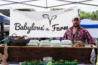 Jon McKee sells fresh vegetables from Babylove's Farm in McKinney on Saturday morning at the Denton Community Market. WIC voucher participants can exchange their vouchers for his farm's okra, bell peppers, eggplants and more. Kyle Martin/DRC