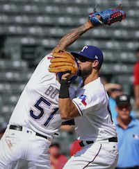 Rangers relief pitcher Matt Bush (51) and third baseman Joey Gallo (13) collide while trying to catch an infield fly ball in the eighth inning of Sunday's game against the Chicago White Sox in Arlington. The play resulted in both players leaving the game.AP