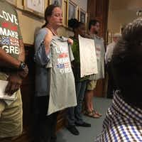 "At Tuesday's Commissioners Court meeting, people lined up against the back wall of the courtroom to speak out against the Confederate monument on the Square. Some held signs in protest, while others wore T-shirts reading, ""Love, not hate, makes America great.""DRC"
