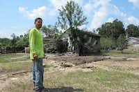 Rafael Casas tours his storm-ravaged house Friday in Crosby. His home is in a small working-class neighborhood that sits between two Superfund sites, French LTD and the Sikes Disposal Pits. AP