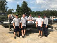 A six-member water rescue squad from Denton stands in front of a boat they used to rescue hundreds of people around Houston after Hurricane Harvey. The squad included, from left, firefighters Kevin Tye, Alan Hempstead, Clint Stephenson,  Vance Bowden, Capt. Jared Hornback and Capt. Brian Cox.Brian Cox