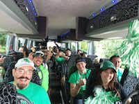 "<p><strong style=""font-size: 1em; background-color: transparent;"">Fans head from downtown Denton to Apogee Stadium for a University of North Texas football game in 2015 aboard one of the Mean Green Game Day shuttles. The shuttles will begin running at 2:30 p.m. for the Sept. 23 game against the University of Alabama-Birmingham.</strong></p>Denton Convention & Visitors Bureau"