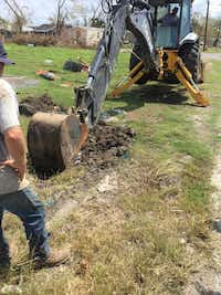 A Denton public works crew digs to reach a broken water main in Refugio. Debris from Hurricane Harvey is still noticeable in the area.City of Denton