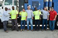 From left to right, city of Denton workers David C. Warren Sr., Rivers Earls Jr., Glen Harrison, Brian Meadows, Byron Broussard, Kyle Hubbert and Drew Huffman, pose Friday for a portrait at city of Denton Fleet Services.  The group went to the Texas Gulf Coast to help make repairs in Refugio, Lake Jackson and Brazoria. They were part of a statewide public works response team that stepped in to help the public works crews in those towns, who were overwhelmed by the work they needed to do.DRC