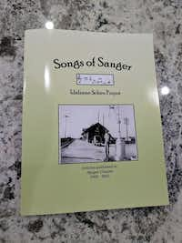"""Songs of Sanger: Articles Published in the Sanger Courier 2003-2009"" collected by Idaleene Scheu Fuqua.Staff photograph"