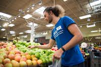 Kyle Gaynor, a Kroger employee, selects produce that a customer has purchased. Kroger's employees choose the best produce they can find available and will follow given instructions from the shopper such as the ripeness of a given fruit.DRC