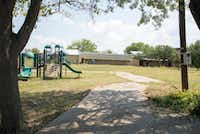 "<p><span style=""font-size: 1em; background-color: transparent;"">Playground equipment and classroom buildings can be seen Monday at the former location of the Selwyn School at 3333 W. University Drive in Denton. The school moved to a new location near Copper Canyon earlier this year. </span><span style=""font-size: 1em; background-color: transparent;"">The property on which the school formerly stood could be foreclosed on soon by Volunteer Enterprises, a Pilot Point-based company that loaned Selwyn $3.2 million and placed a lien on the private school's property. </span></p>DRC"