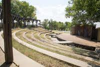 Grass and weeds have begun to overtake the amphitheater at the Selwyn School's former location, as seen here Monday.DRC