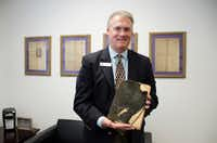 Denton High School principal Joel Hays, a 1984 DHS graduate, shows off a 1914 Denton High yearbook. The book was given to him by a former classmate who bought it in a garage sale.Denton Record-Chronicle