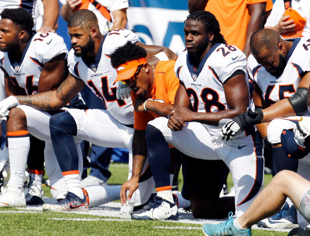 #TakeTheKnee sparks national conversation after Trump's comments