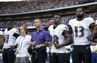 Baltimore Ravens head coach John Harbaugh, center left, links arms with his daughter Alison and wide receiver Jeremy Maclin (18) during the playing of the U.S. national anthem before Sunday's game against the Jacksonville Jaguars at Wembley Stadium in London. Also pictured are Breshad Perriman (11) and Chris Matthews (13).AP