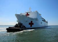 The Military Sealift Command hospital ship USNS Comfort (T-AH 20) departs Naval Station Norfolk to support hurricane relief efforts in Puerto Rico, on Friday in Norfolk, Va. (Bill Mesta, U.S. Navy/AP)