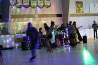 Skaters roll past while Denton band Puddin Taine performs Sept. 23 at Lone Star Indoor Sports and Event Centers in Denton. The indoor roller rink plans to host live music twice a month. (Courtesy photo)