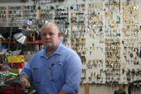Douglas Smith, a 50-year-old locksmith at Laura's Locksmith & Security Store, shared his expertise with Denton firefighters who were trying to open a gun safe that a young girl was trapped inside on Tuesday. He warned against tampering with the locking mechanism on the safe's door.DRC
