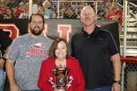 Argyle ISD Superintendent Telena Wright stands between Argyle Town Manager Matt Jones, left, and Argyle Mayor Don Moser with the 2017 Class Lone Star Cup. The cup is awarded to schools in each classification that rack up the most points based on achievement in academics, sports and fine arts. Argyle won the 4A division for the sixth straight year and eighth time overall. It was presented to the school by the University Scholastic League during halftime of the Eagles' game against Wylie High School of Abilene on Sept. 22.Courtesy photo