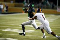 North Texas sophomore wide receiver Rico Bussey, Jr. (8) narrowly escapes Texas-San Antonio defensive back Devron Davis on his way to the end zone for thegame-winning touchdown to cap a 98-yard in the final minute of a 29-26 win at Apogee Stadium. The drive was another sign of progress for UNT offensively under head coach Seth Littrell.DRC