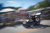A racer goes down Hickory Street during the coffin races at the Day of the Dead Festival, Saturday, October 29, 2016, in Denton, Texas, Jeff Woo/DRCDRC