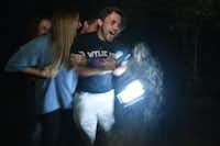 Claire Railsback and Preston Brower react as a monster jumps out at them at the Dark Path Haunt, Saturday, October 25, 2014, in Denton, TX. David Minton/DRCDRC