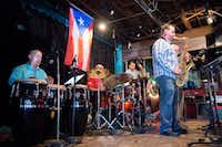 "Jose Aponte & Caribe Club perform during ""Denton Hearts Puerto Rico"" at Dan's Silverleaf on Sunday. Aponte, a UNT professor who moved to Denton 22 years ago, has family in Puerto Rico.DRC"