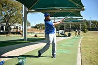 Robert Reyna enjoys the fall weather by hitting some golf balls Wednesday at North Lakes Driving Range.  Wednesday's high was in the upper 70s, but temperatures are predicted to drop towards the end of the week.DRC