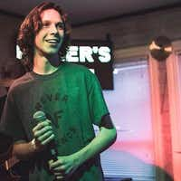 Sixteen-year-old Daniel Gould takes the microphone at a show he put together at Killer's Tacos in Denton.Courtesy Photo