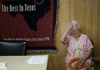 Mayor Olive Stephens jokes around with the Shady Shores Town Council before a budget meeting in 2005.The Dallas Morning News