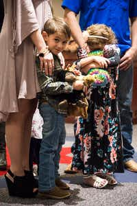 Brayden Vivian, 5, left, smiles as he and his sister Skylar, 6, are adopted Friday during Denton County Adoption Day by their aunt and uncle, Tamara and Cody Vivian. The adoption became official in Judge Bruce Farling's courtroom in the Denton County Courts Building.DRC