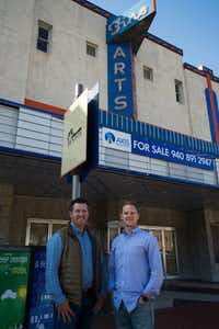 Alex Payne, left, and Brad Andrus with Axis Realty Group pose for a photo in front of the Fine Arts Theater on Denton's downtown Square.  The building was recently listed for sale by Axis Realty Group.DRC