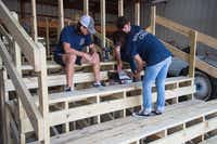Christian Burkhart, left, Sylvia Burkhart, right, and CJ Massey, back, with the Argyle chapter of the Young Men's Service League, help construct bleachers for use at Cumberland's Presbyterian Children's Home on Saturday.DRC